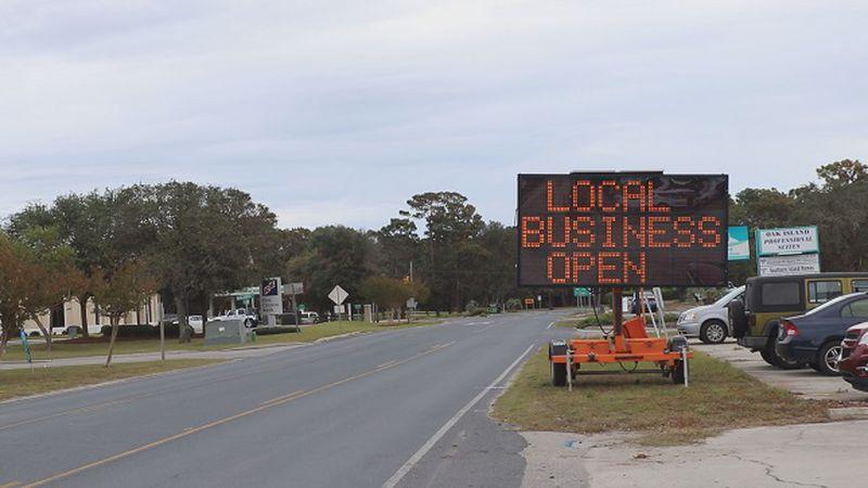 Sign in Oak Island signaling that local businesses are still open despite the temporary closure...