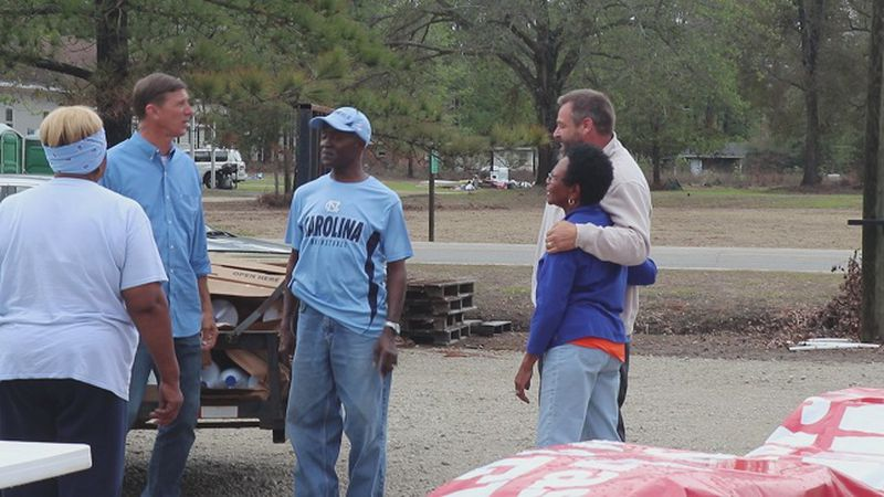 Daniel Blevins helping out residents of Whitestocking Road. (Source: WECT)
