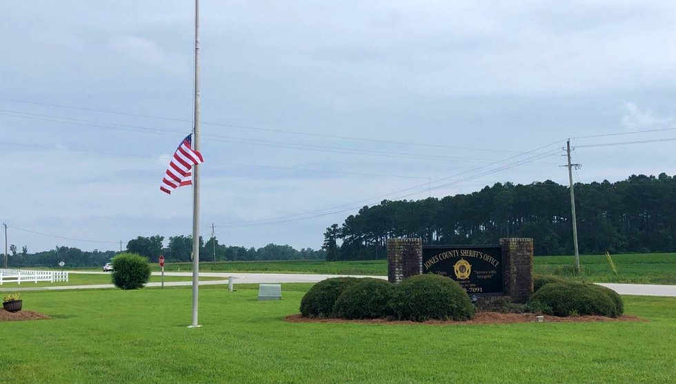A flag outside the Jones County Sheriff's Office flies at half-staff Tuesday.