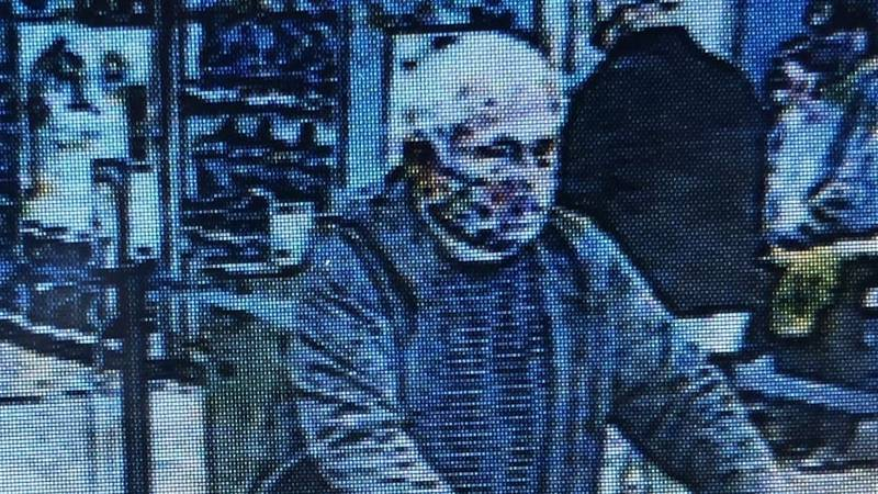 Leland Police are searching for this man in connection to a larceny at the Leland Walmart.