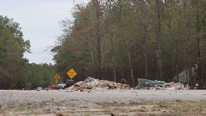 Debris still piled up on Whitestocking Road in Burgaw. (Source: WECT)