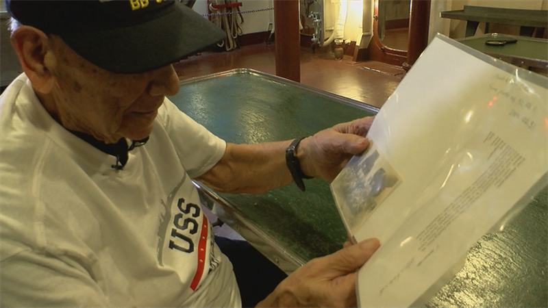 Pat Fonzi, a World War Two veteran, holds a picture of his fellow crew members on the...