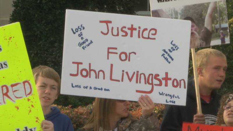 Friends and family of John Livingston protest his death following a deadly shooting by Deputy...