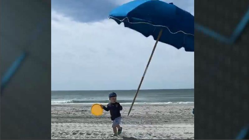 One family's day at the beach almost took a tragic turn after a toddler was nearly impaled by a...