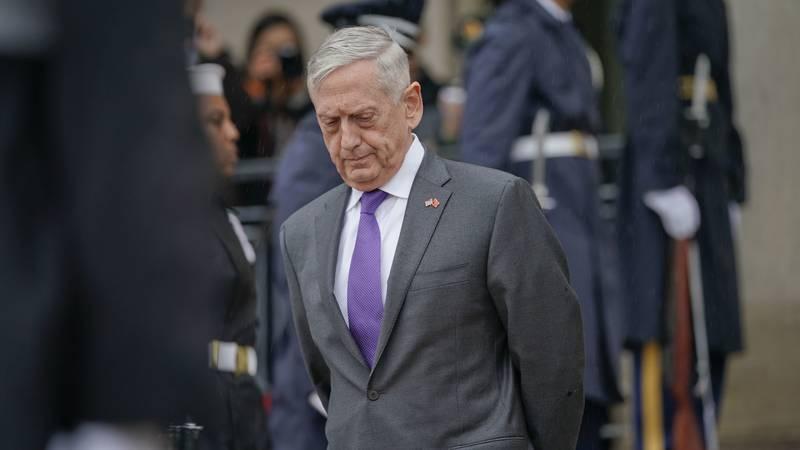 FILE - In this Nov. 9, 2018 file photo, Defense Secretary Jim Mattis waits outside the Pentagon.