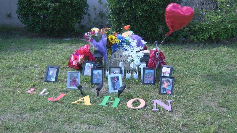 A memorial sits along Dawson Street near where the crash happened on Monday. Photo taken...