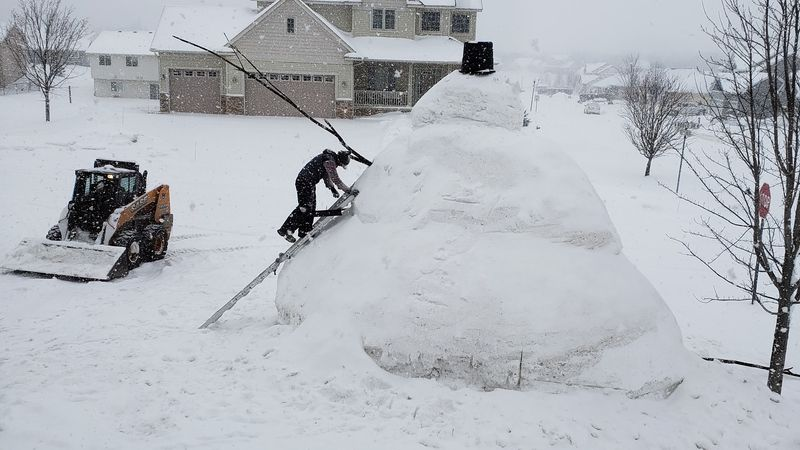 Eric Fobbe builds a 20-foot snowman in his yard in Buffalo, MN.
