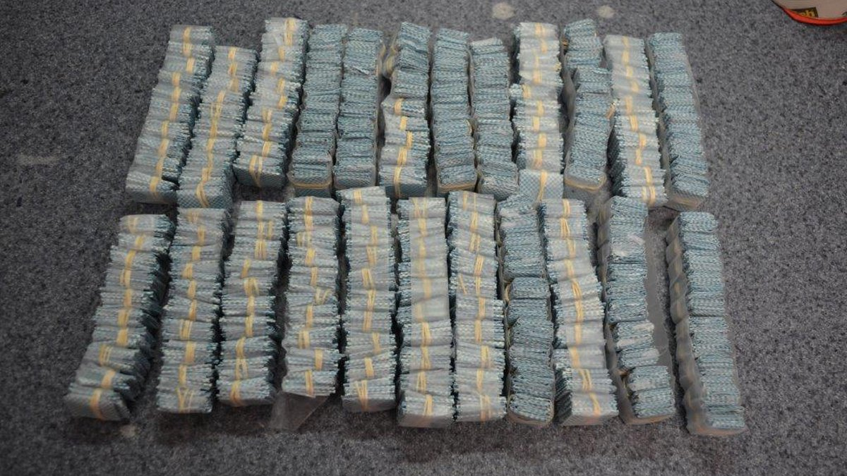 Detectives seized over 5,700 bags of heroin, 80 grams of marijuana, and 14 grams of crack...