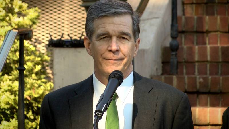Governor Roy Cooper listens to a question from WBTV Chief Investigative Reporter Nick Ochsner...