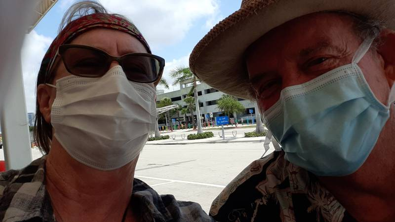 Katy O'Neil and John Hutton on their way to the Miami International Airport after being...