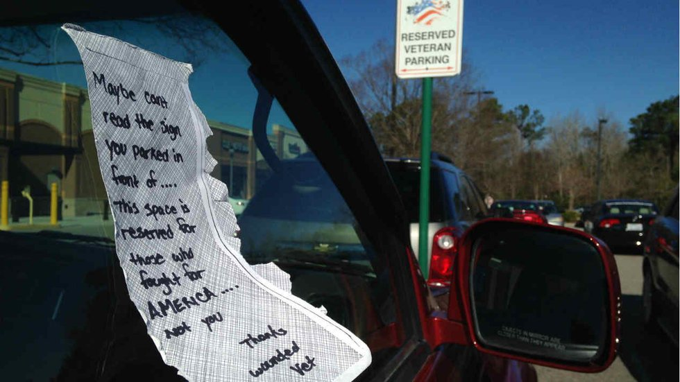 """It read, """"Maybe [you] can't read the sign you parked in front of. This space is reserved for..."""