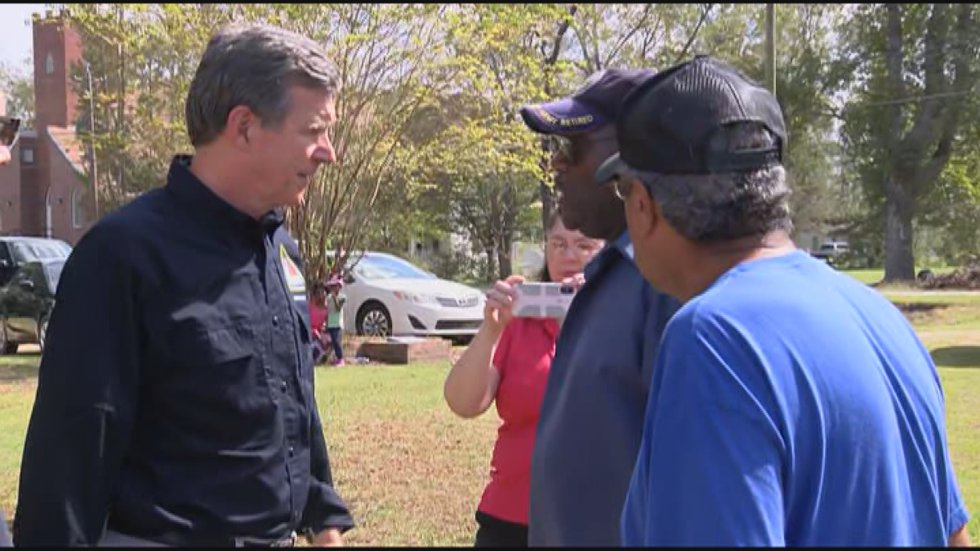 Governor Roy Cooper spoke with Hurricane Florence victims in Bladenboro. (Source: WECT)
