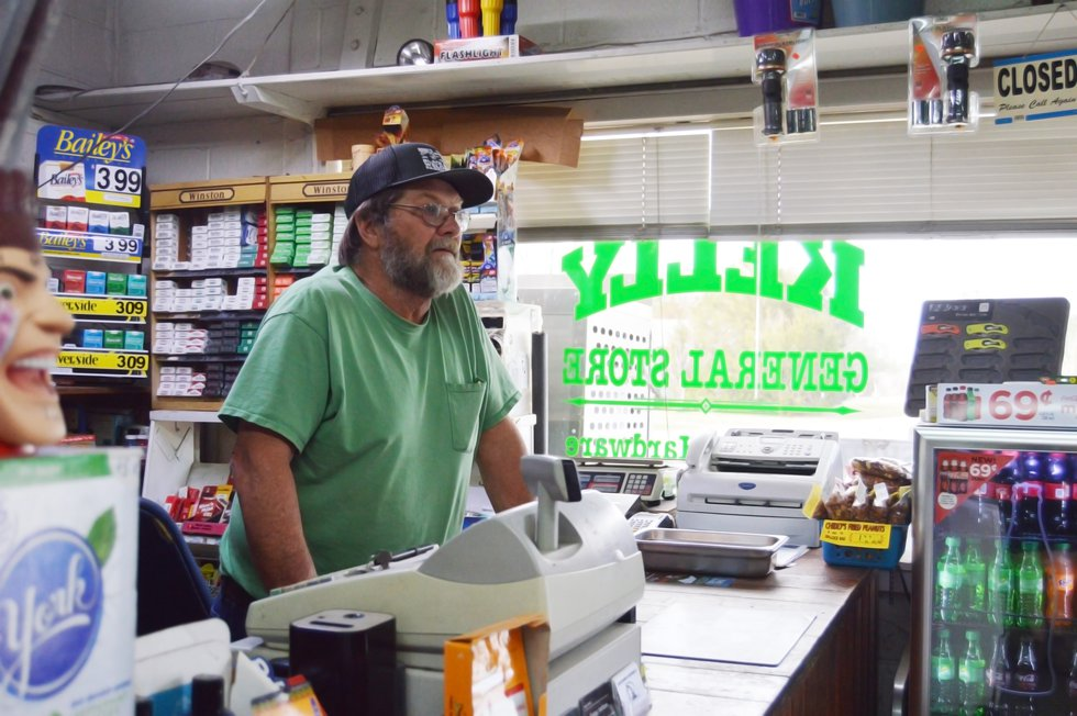 Charles Russ stands behind the counter of the Kelly General Store.