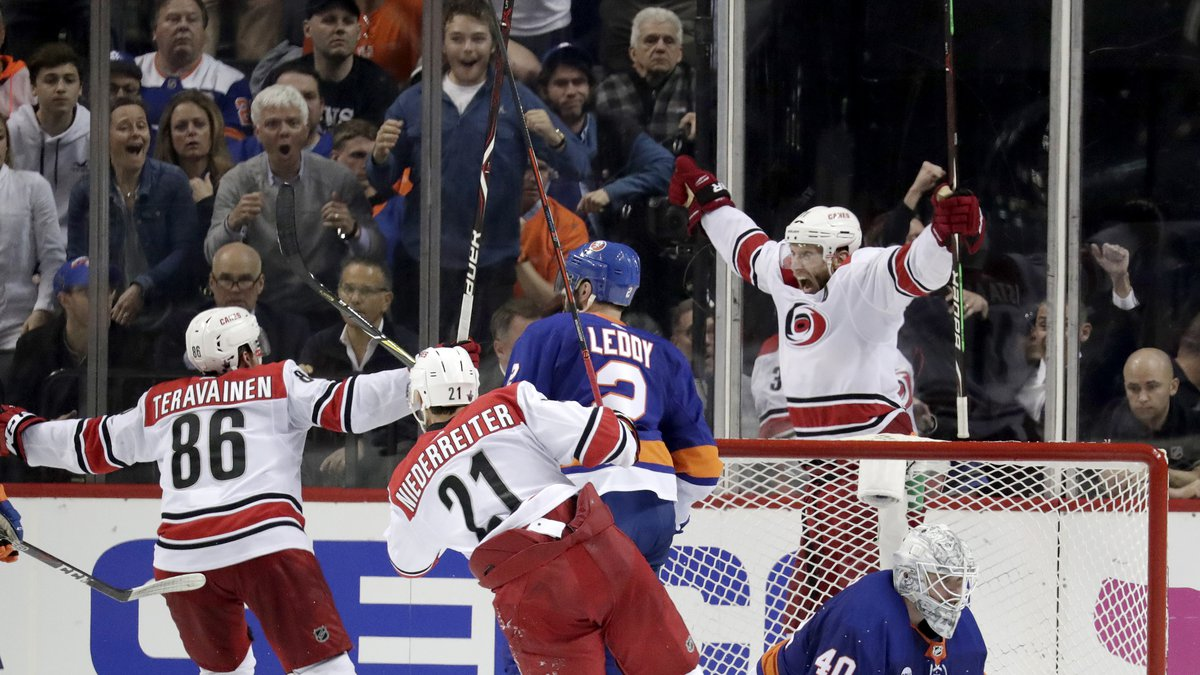 Carolina Hurricanes center Jordan Staal, top right, reacts after scoring an overtime goal on...