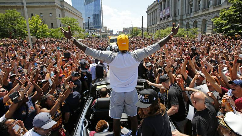 FILE - In this June 22, 2016, file photo, Cleveland Cavaliers' LeBron James, center, stands in...