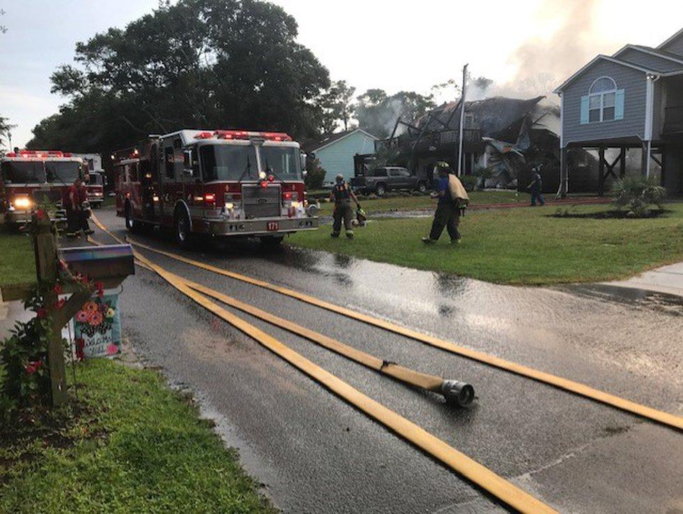 Oak Island house fire damage