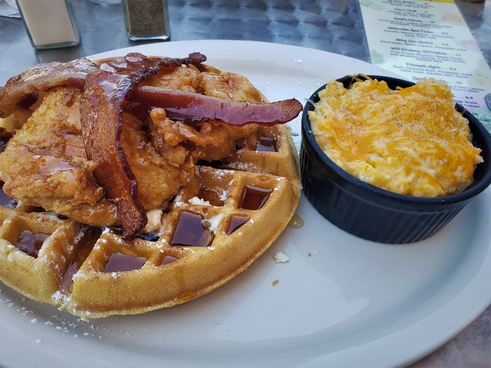 Chicken and Waffles, a staple of just about every brunch menu, is given justice here at Rooster...