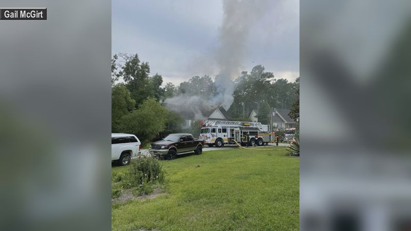 Crews battle a House Fire on Motts Creek Road on Saturday.