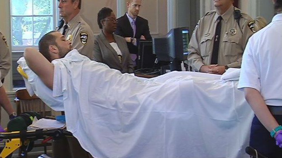 Lance Powers was on a stretcher during his first court appearance.