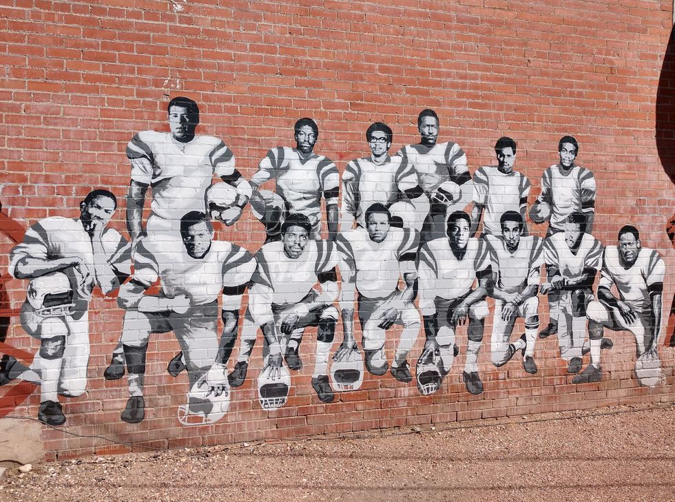 A mural commemorating the 1969 University of Wyoming Black 14.
