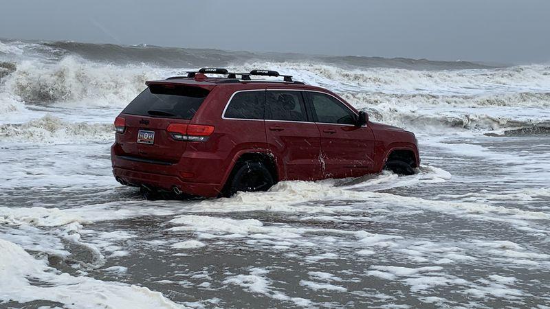 A driver abandoned their Jeep on the beach as Hurricane Dorian hit Myrtle Beach