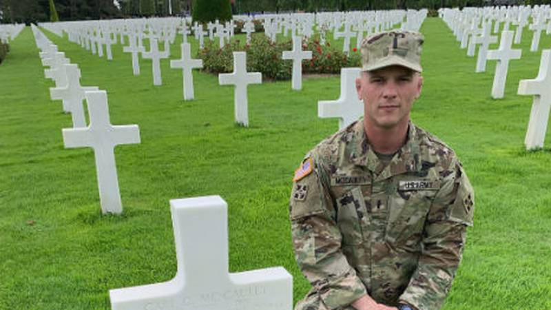 Lt. Samuel McCauley visits the French grave site of his great uncle, Carl McCauley.