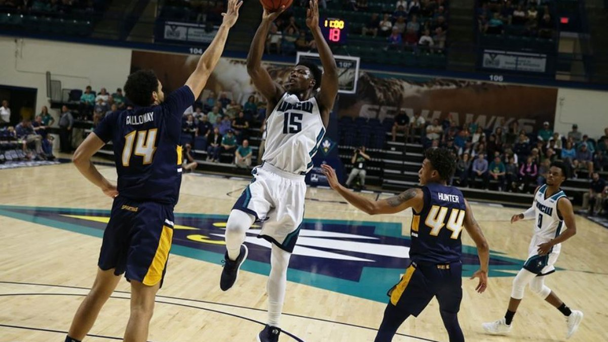 Devontae Cacok scored 17 points and grabbed 16 rebounds for UNCW in Tuesday's loss to UNCG.