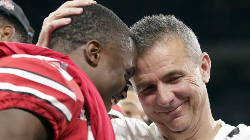 Ohio State head coach Urban Meyer and wide receiver Terry McLaurin, left, celebrate early...