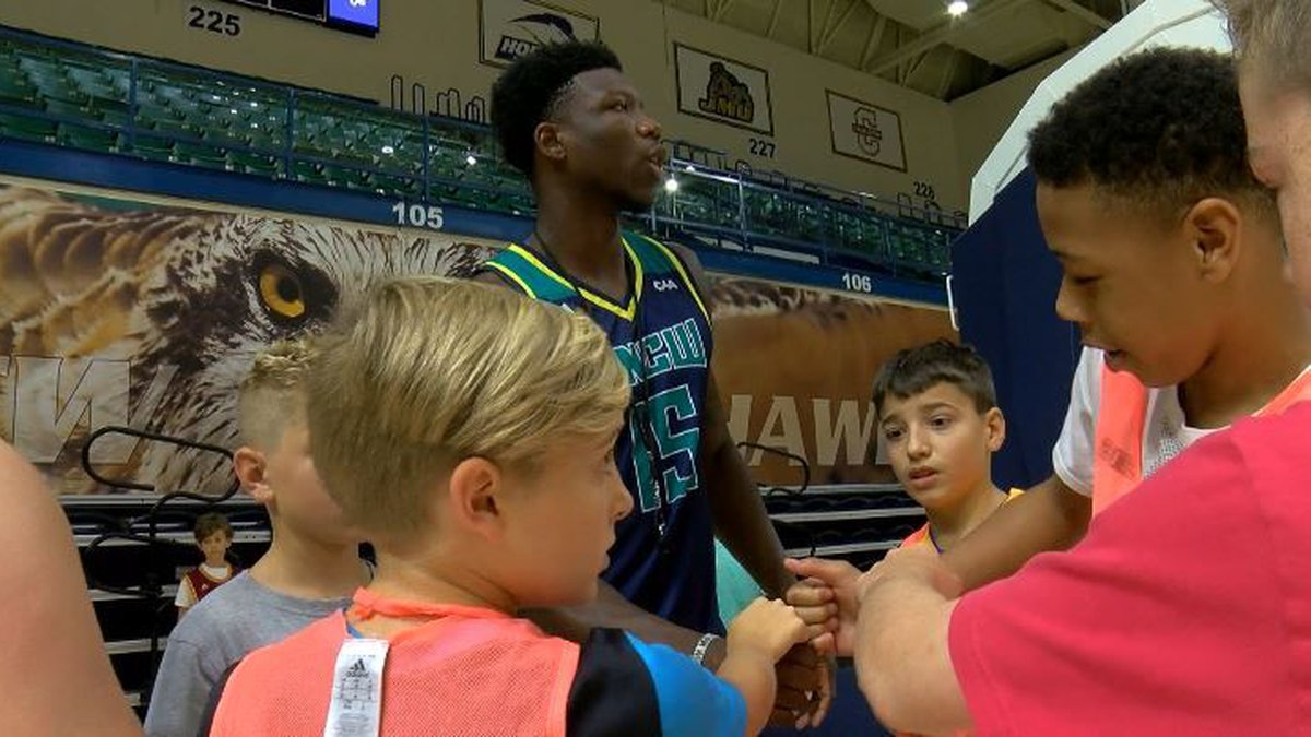 UNCW's DeVontae Cacok gives his team one last speech before they play (Source: WECT)