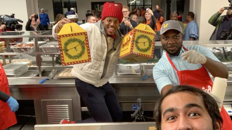 Newton and the Bojangles' crew served a hot meal to neighbors at the Men's Shelter and...