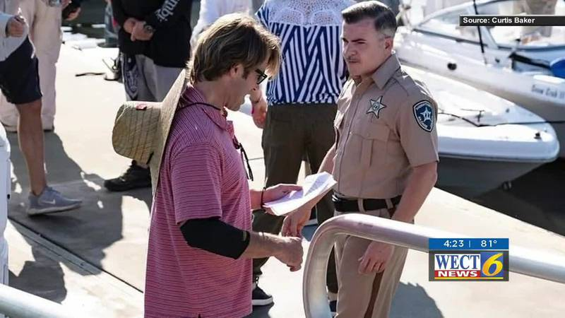 Jonas Pate one of the creators of the Netflix show 'Outer Banks' seen on the set with actor...