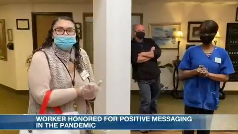 Worker honored for her positive messaging during pandemic.