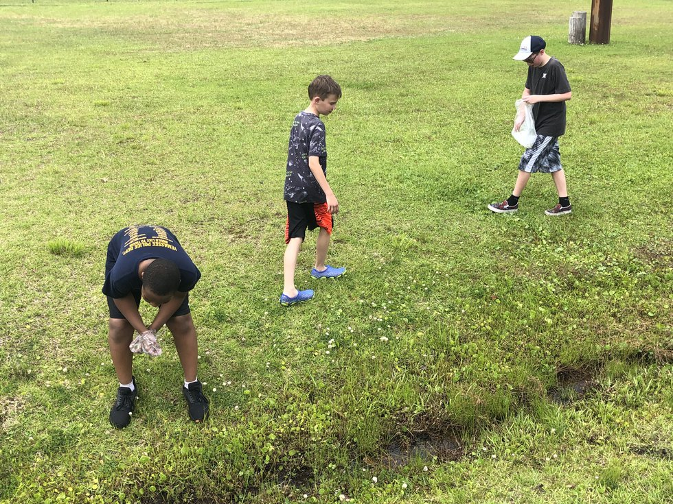 Chicken Squad members clean up campus after Castle Hayne Elementary School's Fun Day recently.