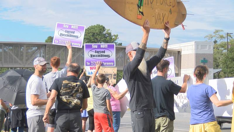 Crowds protest the vaccine mandate for Novant Health employees.