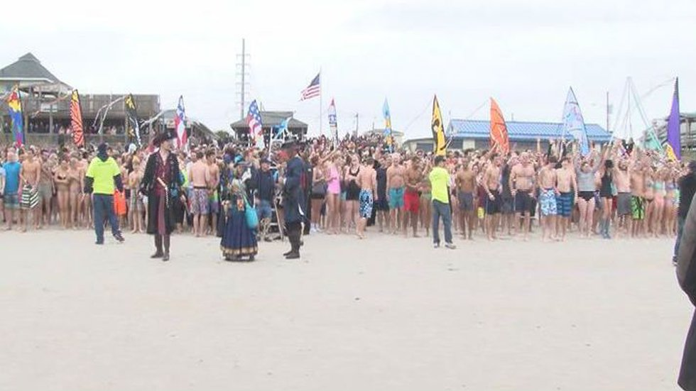 More than 2,500 people gathered in Surf City Wednesday to start 2014 off on a cold foot with...