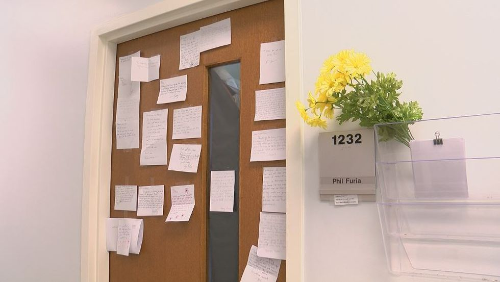 Phil Furia's door at UNCW is littering with condolence messages from students and staff...