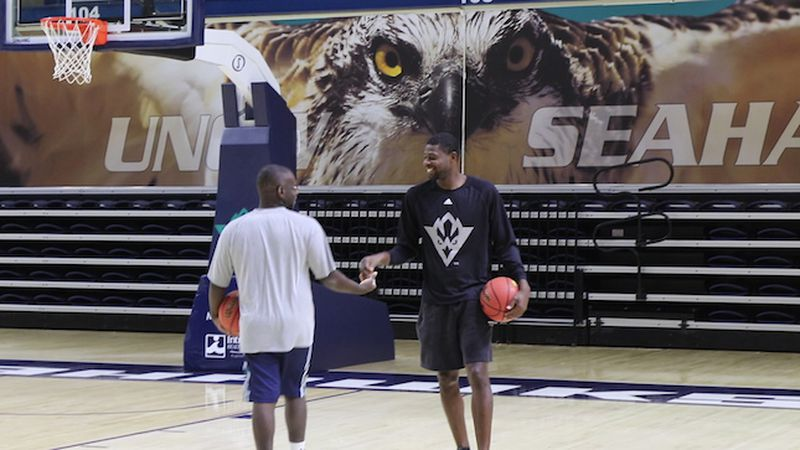 UNCW Men's Basketball equipment director, Christian White on the basketball court. (Source: WECT)