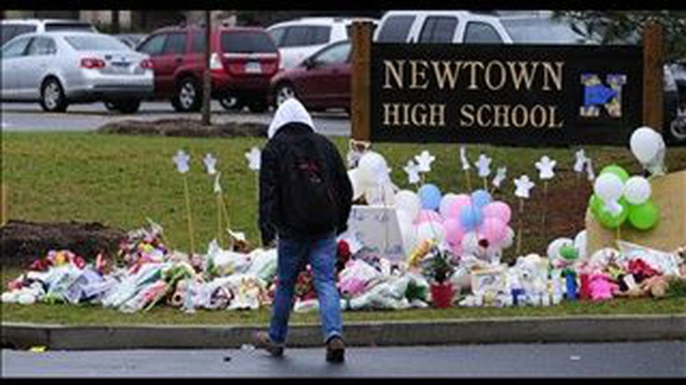 A student returns to classes at Newtown High School. (Source: MGNonline/Patrick Raycraft)