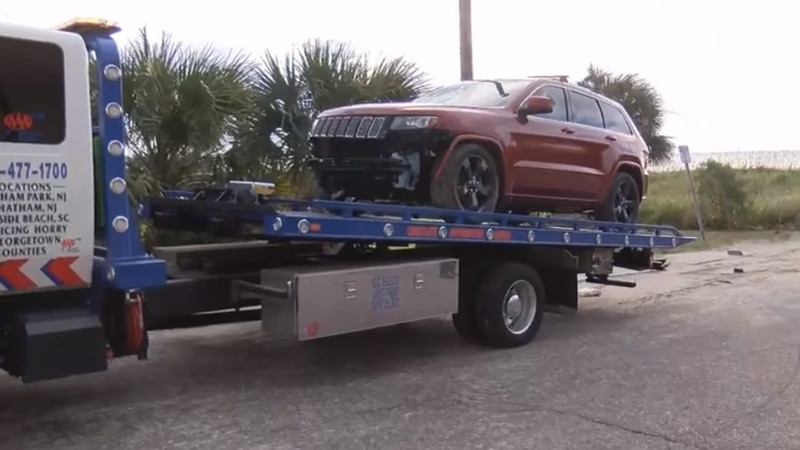 The infamous red Jeep was removed from the beach Friday morning by Myrtle Beach workers.