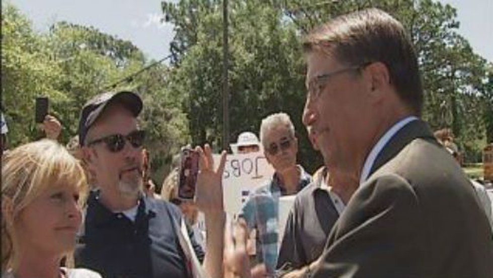 Gov. Pat McCrory stopped to talk with pro-film industry demonstrators after an interview in the...